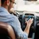 multa por dirigir veículo segurando telefone celular